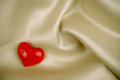 Heart on the satin Royalty Free Stock Photos