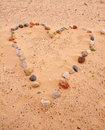 Heart of sea stones on sand Royalty Free Stock Photo