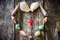 Heart of seashells, shells, shells, sea stars on a wooden Royalty Free Stock Photo