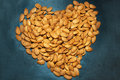 Heart shape from almond nuts texture Royalty Free Stock Photo