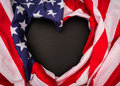 .Heart shape American flag on black background . Royalty Free Stock Photo