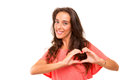 Heart shape beautiful woman making a with her hands isolated over white background Royalty Free Stock Photo