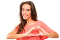 Heart shape beautiful woman making a with her hands isolated over white background Royalty Free Stock Photography