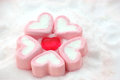 Heart shape candy around by marshmallows on snow red pink Royalty Free Stock Images
