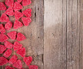 Heart shape candy on wooden plank Stock Image
