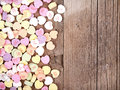 Heart shape candy on wooden plank Royalty Free Stock Image