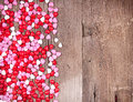 Heart shape candy on wooden plank Stock Images