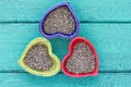 Heart shape ceramic bowls with Chia seeds Royalty Free Stock Photo