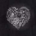 Heart shape chalk drawing on chalkboard blackboard.Floral heart.