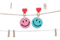 Heart  shape clip on a  twine, hanging Smiley Face COUPLE Royalty Free Stock Photo