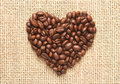 Heart shape coffee beans on sacking Royalty Free Stock Image