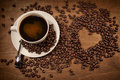 Heart shape from coffee beans on wood Royalty Free Stock Photo