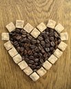 Heart shape Coffee Beans on wooden background Stock Image