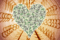 Heart shape with dollar bill Stock Images