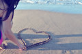 Heart shape drawing a in a sand Stock Photo