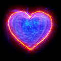 Heart shape energy abstract on black background Stock Image
