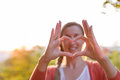 Heart shape with fingers and thumb woman making using selective focus Royalty Free Stock Image
