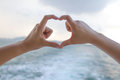 Heart shape hands made with two human Royalty Free Stock Photo