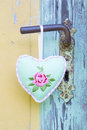Heart shape hanging on rusty door handle for valentine christma christmas wedding mother s day or anniversary country style Royalty Free Stock Images