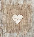 Heart shape made of birch bark on the burlap Royalty Free Stock Photography