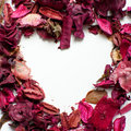 Heart shape made with dry flowers leaves and on a white background copy space Stock Photos