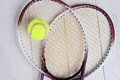 Heart shape made from tennis rackets close up on tennis racket and ball sport equipment background wallpaper Royalty Free Stock Photo