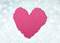 Heart shape made from torn paper over glitter boke soft lights Royalty Free Stock Images