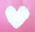 Heart shape made from torn paper over glitter boke soft lights Royalty Free Stock Image