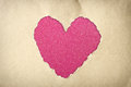 Heart shape made from torn paper over glitter boke soft lights Royalty Free Stock Photo