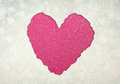 Heart shape made from torn paper over glitter boke soft lights Stock Images