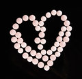 Heart shape pink  pills Royalty Free Stock Photo