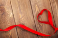 Heart shape ribbon over wood valentines day background with copy space Royalty Free Stock Photos