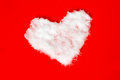 Heart shape of snow on red background Royalty Free Stock Image