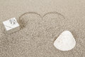 Heart shape symbol drawn in sand for natural love conceptual with space for text Royalty Free Stock Photography