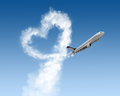 Heart shape of track from plane on blue Royalty Free Stock Photo