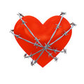 Heart shape wrapped with barbed wire Stock Images