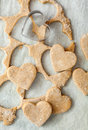 Heart shaped biscuits cookie cutter on raw cookie dough with a few cookies Royalty Free Stock Image