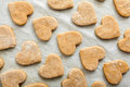 Heart shaped biscuits cookies on baking paper ready to cook Stock Photos