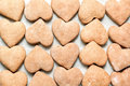 Heart shaped biscuits cookies cooked on parchment paper Stock Photography