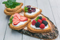 Heart shaped biscuits spread with quark, strawberries, blackberr Royalty Free Stock Photo
