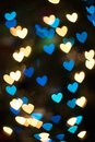 Bokeh background with unique heart shaped  lights or blurred lights background Royalty Free Stock Photo