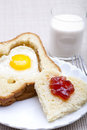 Heart shaped bread and egg Stock Photo