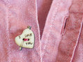 Heart shaped button Stock Images