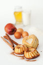 Heart-shaped cake and ingredients Stock Photos