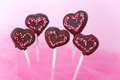 Heart shaped cakepops chocolate covered as hearts with pink sprinkles Royalty Free Stock Photos