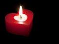 Heart shaped candle isolated on black background Royalty Free Stock Photo
