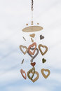 Heart shaped ceramic wind mobile hanging with defocused blue sky Royalty Free Stock Photo