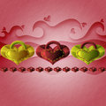 Heart shaped charms in line with swirly crumpled background Royalty Free Stock Images