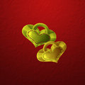 Heart shaped charms with stitches shape on crumpled red background Royalty Free Stock Image