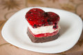 Heart shaped chocolate cake. cake in the shape of a heart on a white plate. Royalty Free Stock Photo
